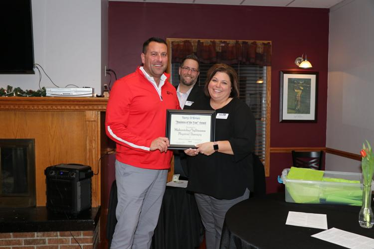 Cory Sylliaaasen accepts the Business of the Year award from Chamber Executive Assistant Jennifer Woita and Chamber President Ryan Ideus.